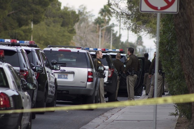 Las Vegas police officers respond to the scene of an officer-involved shooting on Sunday near South Mojave Road and East Harmon Avenue. (Kristen DeSilva/Las Vegas Review-Journal)