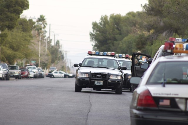 Heavy police activity surrounded the scene of an officer-involved shooting near South Mojave Road and East Harmon Avenue on Sunday. (Kristen DeSilva/Las Vegas Review-Journal)