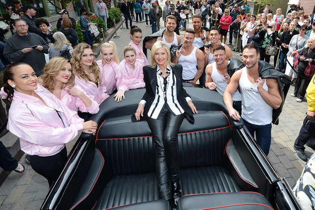 """Olivia Newton-John is greeted by Las Vegas entertainers from the shows """"Jubilee"""" and """"Chippendales"""" during her welcome event to celebrate her residency at Flamingo on April 2, 2014. The Flamingo a ..."""