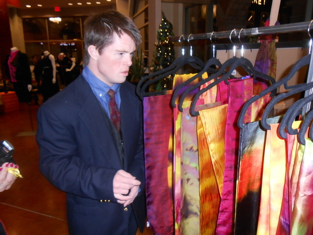 Opportunity Village client Donald H. (last name withheld), who said his passion is drumming but is also an artist, checks out artwork on display Nov. 20, 2014 at Vasari in Tivoli Village. (Jan Hog ...