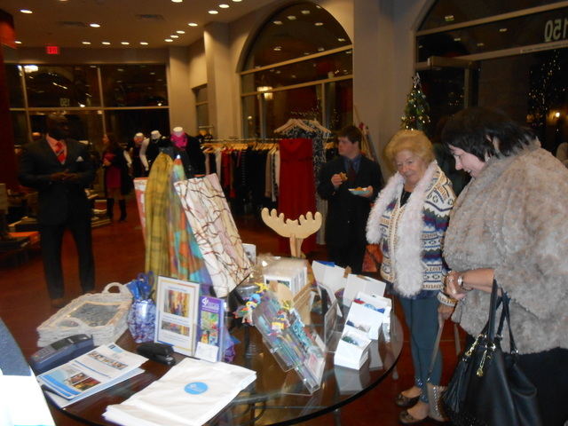 A center display, seen Nov. 20, 2014 at Vasari, holds items painted or crafted by clients of Opportunity Village. The items are for sale through Christmas and include paintings, cards, bookmarks a ...