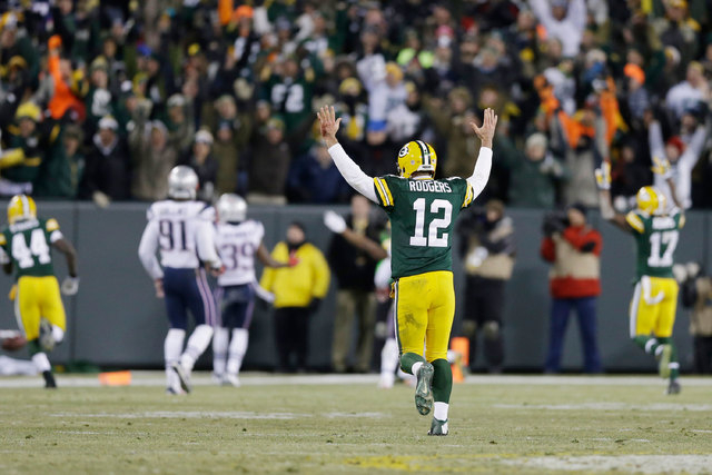 Green Bay Packers quarterback Aaron Rodgers celebrates a 45-yard touchdown pass to Jordy Nelson during the first half of an NFL football game against the New England Patriots Sunday, Nov. 30, 2014 ...
