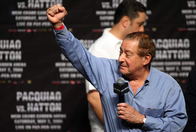 Boxing promoter Bob Arum reacts to Pacquiao fans during Fridays weigh in at the MGM Grand Garden Arena. Manny Pacquiao of the Philippines weighed in at 139 pounds and Ricky Hatton of England weigh ...
