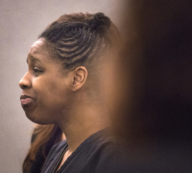 "Dina Palmer, the mother who pleaded guilty in beatings that lead to the death of her 7-year-old son, Roderick ""RJ"" Arrington, speaks during her sentencing, Wednesday, Dec. 03, 2014, at the Regiona ..."