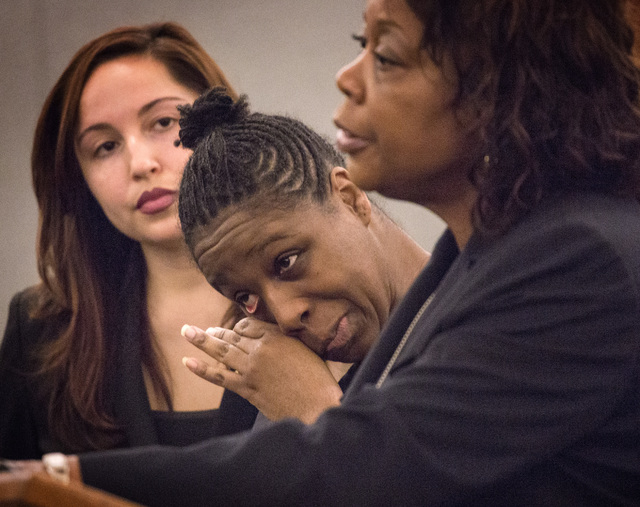"Dina Palmer, the mother who pleaded guilty in beatings that lead to the death of her 7-year-old son, Roderick ""RJ"" Arrington, cries during her sentencing  Wednesday, Dec. 03, 2014. at the Regional ..."