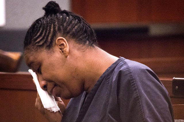 "Dina Palmer, the mother who pleaded guilty in beatings that lead to the death of her 7-year-old son, Roderick ""RJ"" Arrington, cries during her sentencing Wednesday, Dec. 03, 2014, at the Regional  ..."