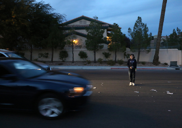 A 10-year--old girl stands in the median while other Metro officers tries to avoid her during a news media pedestrian safety demonstration at Metro's traffic bureau at 8445 Eldora Ave. in Las Vega ...