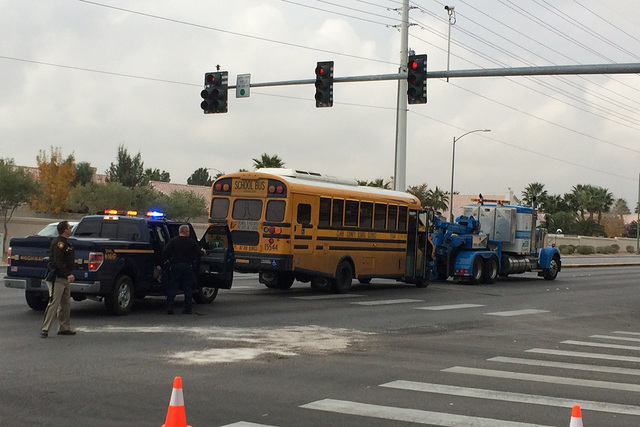 One person was injured Friday morning after a crash involving a school bus in the northwest valley, Las Vegas police said. (Bizuayehu Tesfaye/Las Vegas Review-Journal)