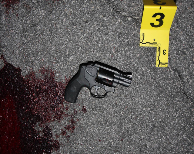 The crime scene at South Pointe Food Mart in Laughlin is shown after an officer-involved shooting there on Jan. 31, 2014. (Las Vegas Metropolitan Police Department)
