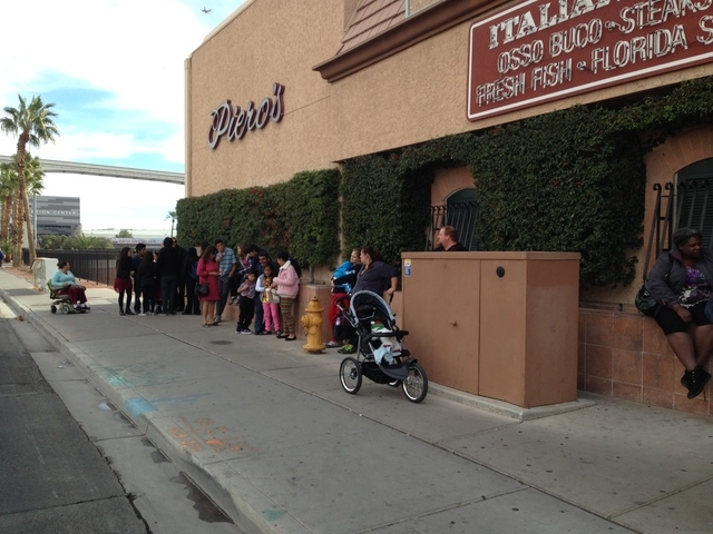 Children and families associated with After-School All-Stars Las Vegas, Catholic Charities of Southern Nevada and the Boys and Girls Clubs of Southern Nevada line up outside Piero's Italian Cuisin ...