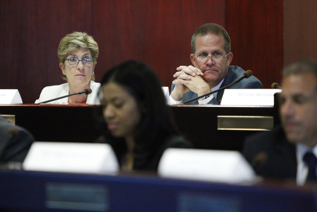 Clark County Commissioner Chris Giunchigliani, left, and Sen. Mark Hutchison, R-Las Vegas, listen to testimony during an Advisory Commission on the Administration of Justice's Subcommittee meeting ...