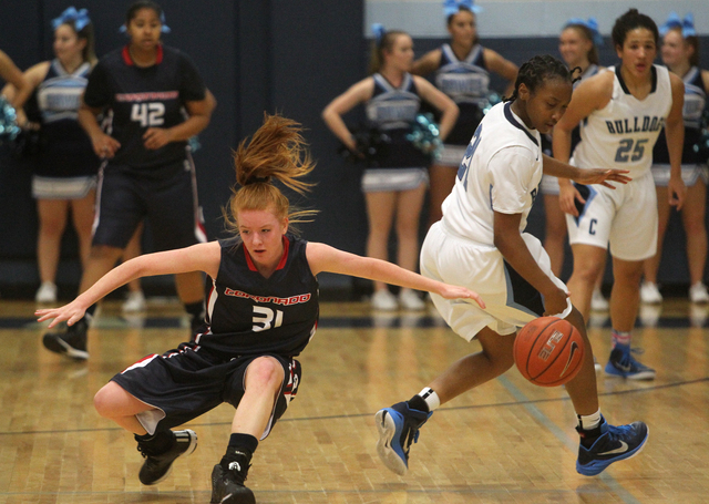 Coronado guard Karlie Thorn (31) loses the ball to Centennial guard Justice Ethridge (21) in the second quarter of a basketball game at Centennial High School in Las Vegas on Wednesday, Dec. 3, 20 ...