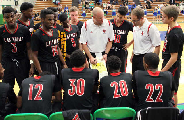 Las Vegas head coach Jason Wilson gives instructions to his players before the start of the third quarter of a prep basketball game against Green Valley at Green Valley High School in Henderson on ...
