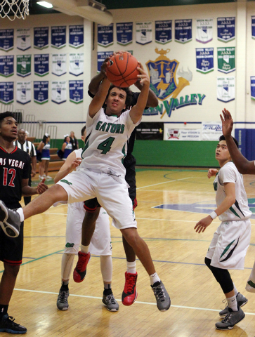 Green Valley shooting guard Xavier Jarvis (4) pulls down a rebound in the fourth quarter of a prep basketball game at against Las Vegas at Green Valley High School in Henderson on Tuesday, Dec. 9, ...