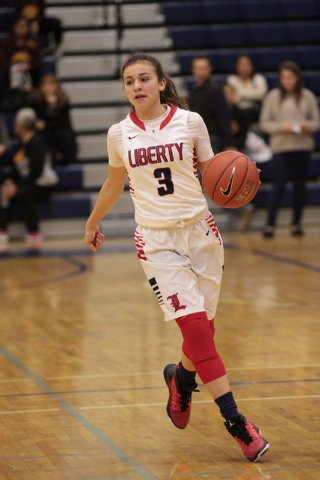 Liberty High School's CeCe Quintino (3) brings the ball down the curt during the first half of a basketball game between Liberty High School and Skyline High School, at Bishop Gorman High School i ...