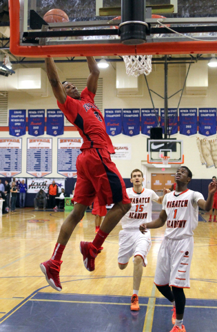 Findlay Prep forward Horace Spencer (0) prepares to dunk in front of Wasatch Academy center Barzin Badan (15) and guard Koby McEwen (1) in the second half of their Tarkanian Classic boys basketbal ...