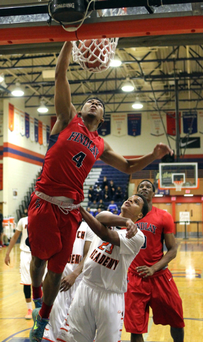 Findlay Prep guard Allonzo Trier (4) dunks in front of Wasatch Academy guard/forward Shamiel Stevenson (23) in the first half during the  Tarkanian Classic on Wednesday. Trier had 27 points as Fin ...