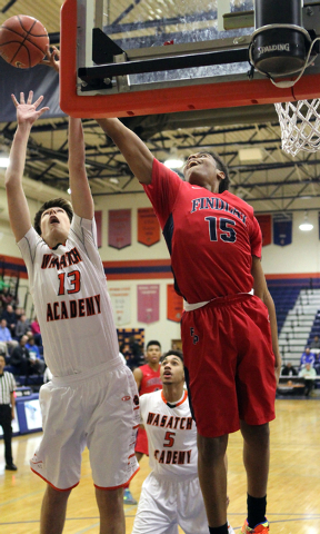 Findlay Prep forward P.J. Washington (15) and Wasatch Academy forward/center Josip Vrankic (13) go for a rebound in the Tarkanian Classic on Wednesay. Washington had 10 points and seven rebounds a ...