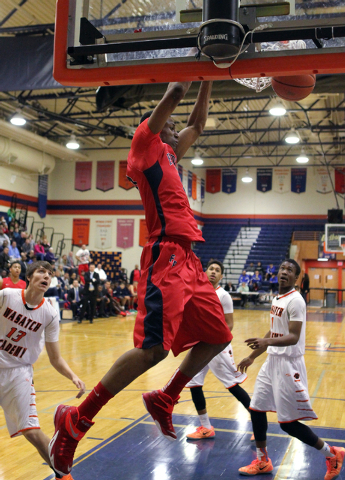 Findlay Prep forward Horace Spencer (0) dunks in front of Wasatch Academy forward/center Josip Vrankic (13),  guard Cody John (5) and guard Koby McEwen (1) in the first half of their Tarkanian Cla ...