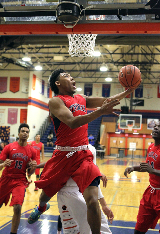 Findlay Prep guard Allonzo Trier (4) goes up for a shot against Wasatch Academy in the first half of their Tarkanian Classic boys basketball tournament game at Bishop Gorman on Wednesday. Trier sc ...