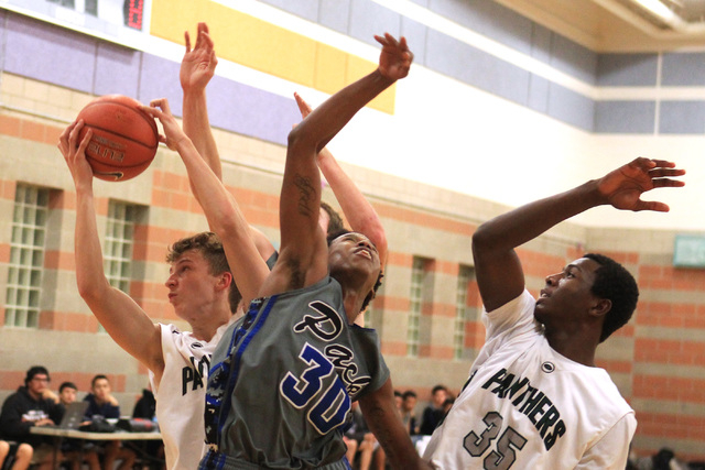 Palo Verde's Grant Dressier grabs a rebound from Basic forward Rob Sutton on Friday. Dressler had 22 points and seven rebounds as Palo Verde won, 78-37. (Sam Morris/Las Vegas Review-Journal)