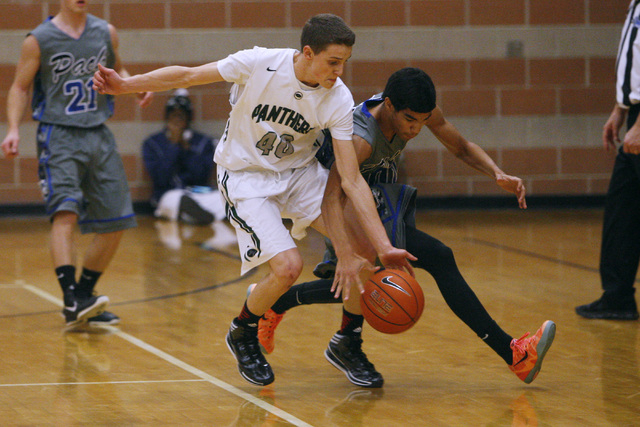 Palo Verde's Thomas Reymond and Basic forward Justice Augustine chase down a loose ball on Friday. Palo Verde won, 78-37. (Sam Morris/Las Vegas Review-Journal)