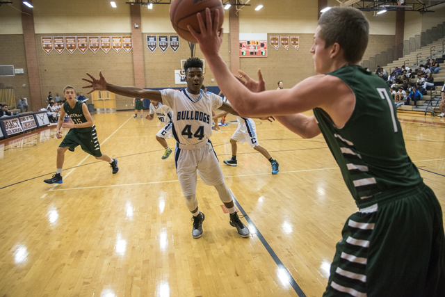 Matt Keis (7) of Robert Bateman High School of Canada passes the ball against Centennial's Kamakana Winquist (44)  during their basketball at Legacy on Thursday. Winquist had seven points in a 71- ...