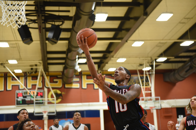 Valley's Cameron Burton (10) goes up for a layup during a game played against Clark High School from Clark's home gym in Las Vegas on Saturday, Dec. 12, 2014. (Martin S. Fuentes/Las Vegas Review-J ...