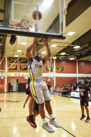 Clark's Ty'Rek Wells (13) goes up for a shot against Valley defenders during their basketball game played at Clark's home gym in Las Vegas on Saturday, Dec. 12, 2014. (Martin S. Fuentes/Las Vegas  ...