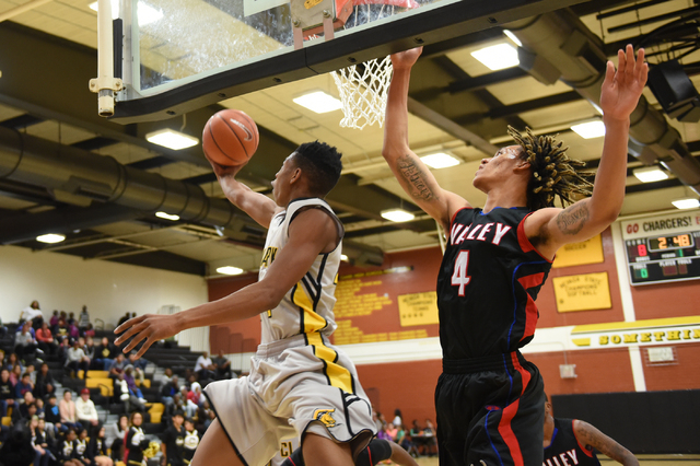 Clark's Darius Jackson (44) goes up for a shot against Valley Taveon Jackson (4) during their basketball game played at Clark's home gym in Las Vegas on Saturday, Dec. 12, 2014. (Martin S. Fuentes ...