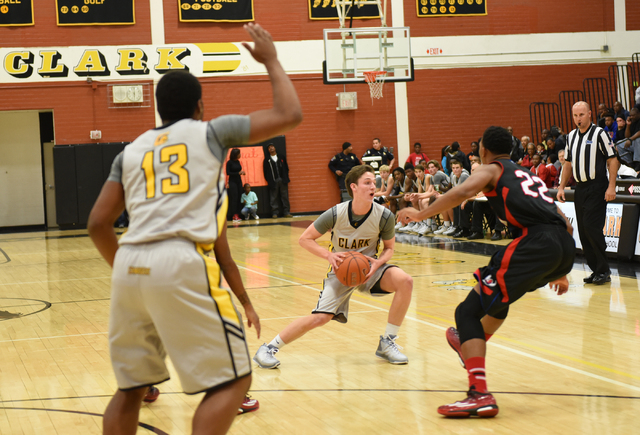 Clark's Carter Olsen (21) center, attempts a pass against Valley's Shea Garland (22) during their basketball game played at Clark's home gym in Las Vegas on Saturday, Dec. 12, 2014. (Martin S. Fue ...