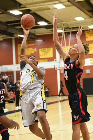 Clark's Keyshawn Webb (1) goes up for a shot against Valley's Taveon Jackson (4) during their basketball game played at Clark's home gym in Las Vegas on Saturday, Dec. 12, 2014. (Martin S. Fuentes ...