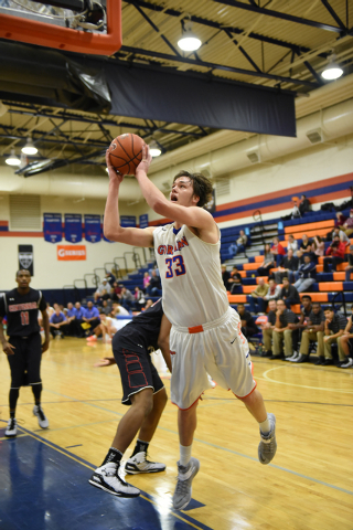 Bishop Gorman's Stephen Zimmerman (33) shoots the ball overCorona Centennial defenders during the third-place game of the Tarkanian Classic on Saturday. Zimmerman had 16 points, nine rebounds and  ...