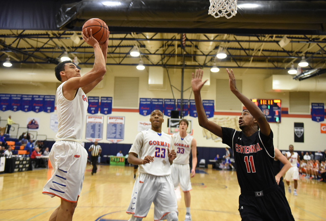 Bishop Gorman's Richie Thornton (2) shoots the ball over Corona Centennial's Jordan Griffin (11) during the third-place game of the Tarkanian Classic on Saturday. Gorman won, 71-51. (Martin S. Fue ...