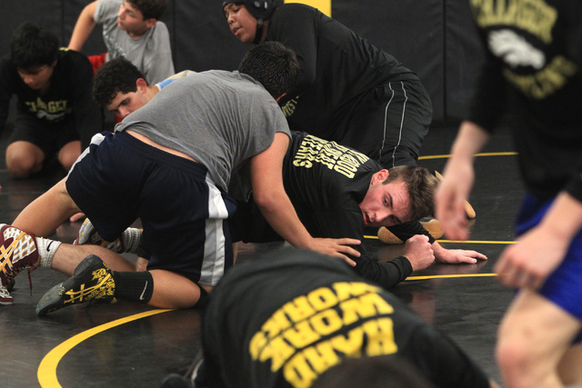Clark High School wrestler Jacob Chaparian works out with Damian Garavito Tuesday, Dec. 2, 2014. (Sam Morris/Las Vegas Review-Journal)