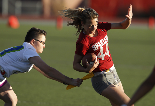 Jaymee Luke of Cimarron-Memorial High School gets tackled by Allisa Hildreth of Green Valley High School in the state championship flag football game at Arbor View High School in Las Vegas Tuesday ...