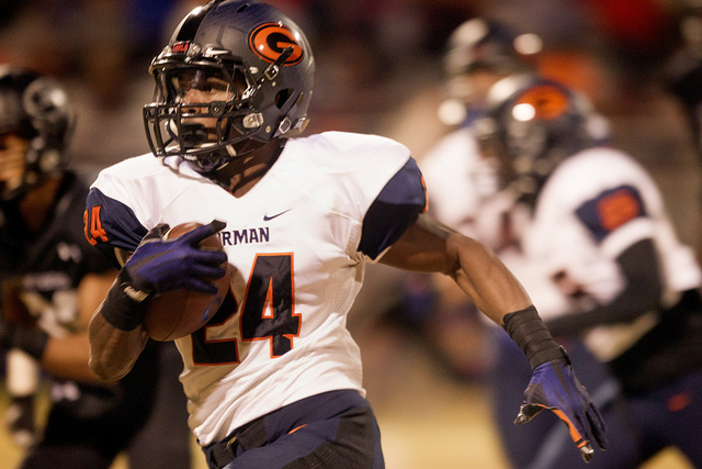 Bishop Gorman halfback Russell Booze drives to the outside to score a touchdown against  local rival Palo Verde,Thursday, Oct. 30,2014.  (Jeff Scheid/Las Vegas Review-Journal)