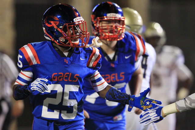 Bishop Gorman wide receiver Tyjon Lindsey celebrates what would be the game winning touchdown against St. John Bosco during their game Friday, Sept. 26, 2014 at Bishop Gorman. Gorman won the game  ...