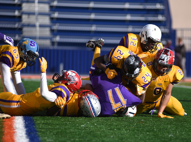 Team Sunrise defense sacks team Sunset quarterback Christian Tasi (17) during the 42nd annual West Charleston Lions Club Charity High School All-Star Football game played at the Bishop Gorman High ...