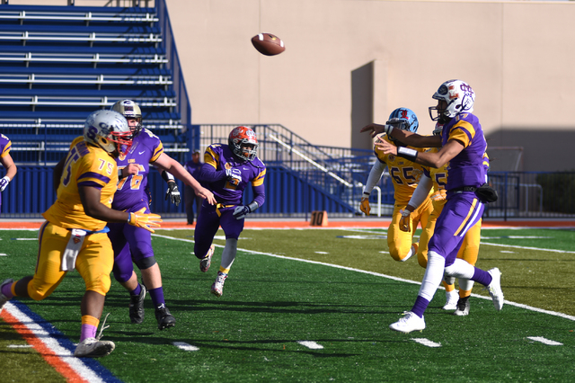 Team Sunset quarterback Christian Tasi (17) throws a pass against team Sunrise defenders during the 42nd annual West Charleston Lions Club Charity High School All-Star Football game played at the  ...