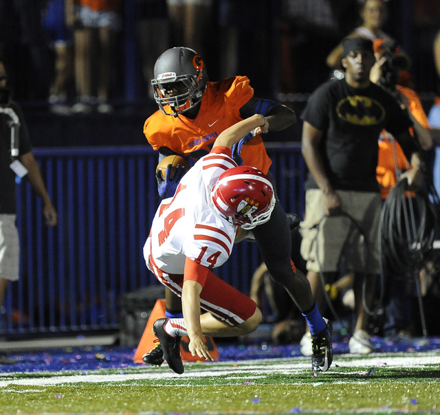Bishop Gorman's Tyjon Lindsey runs over Brophy Prep punter Jack Katzman (14) while returning a punt in the first half of the Sollenberger Classic on Friday. (Josh Holmberg/Las Vegas Review Journal)