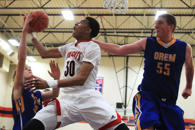 Las Vegas forward Tyler Bey is fouled by Orem forward Noah Johnson and defended by center Richard Harward (55) at the Tarkanian Classic on Thursday.  Las Vegas beat Orem, 63-54. (Sam Morris/Las Ve ...