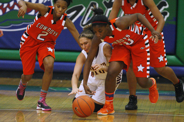 Chaparral guard Jasmine Martin, left, and Marcia Hawkins chase down a loose ball with Dimond of Anchorage, Alaska guard Ne'chelle Martinez during their game at the Gator Winter Classic tournament  ...