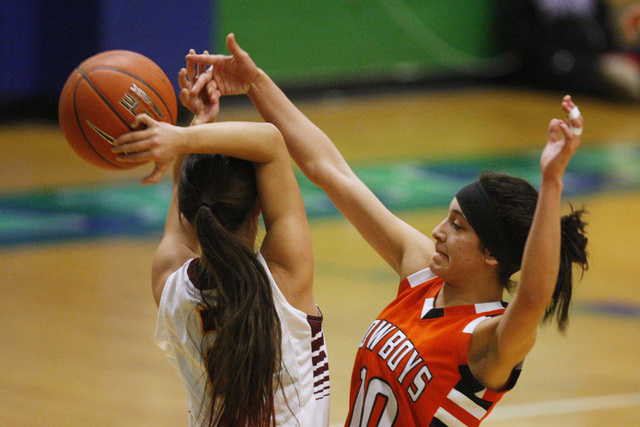 Chaparral guard Abigail Delgado swats the ball away from Dimond of Anchorage, Alaska guard Tiffany Jackson during their game at the Gator Winter Classic tournament Wednesday, Dec. 31, 2014 at Gree ...