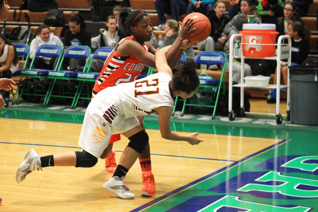 Chaparral guard Marcia Hawkins and Dimond of Anchorage, Alaska guard Shameah Jones chase a loose ball during their game at the Gator Winter Classic tournament Wednesday, Dec. 31, 2014 at Green Val ...