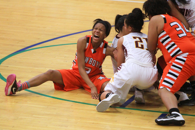Chaparral guard Jasmine Martin screams in pain as a Dimond of Anchorage, Alaska player falls on her leg during their game at the Gator Winter Classic tournament Wednesday, Dec. 31, 2014 at Green V ...