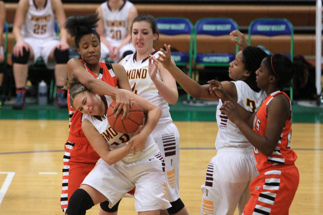 Chaparral center Jade Hazelton fouls Dimond of Anchorage, Alaska guard Ne'chelle Martinez during their game at the Gator Winter Classic tournament Wednesday, Dec. 31, 2014 at Green Valley High Sch ...