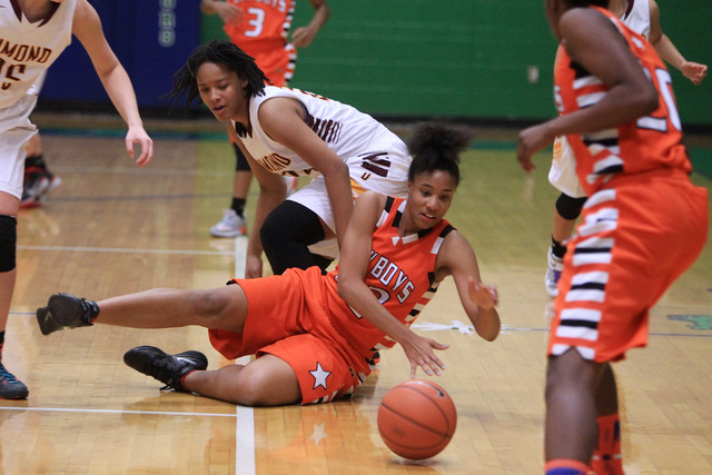 Chaparral center Jade Hazelton rolls a loose ball away from Dimond of Anchorage, Alaska during their game at the Gator Winter Classic tournament Wednesday, Dec. 31, 2014 at Green Valley High Schoo ...