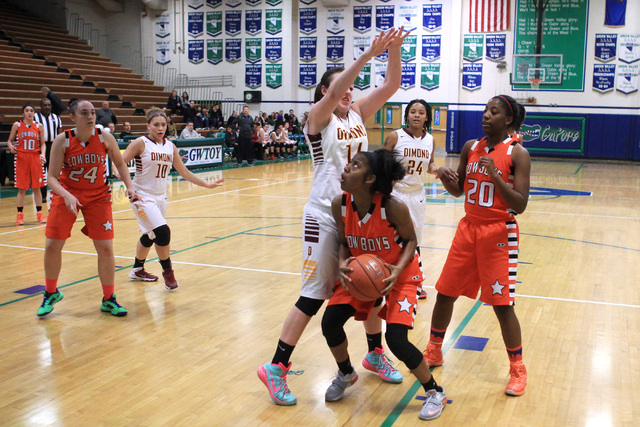 Dimond of Anchorage, Alaska center Lexi Wingert defends Chaparral guard Tiaj Criss-Felton during their game at the Gator Winter Classic tournament Wednesday, Dec. 31, 2014 at Green Valley High Sch ...