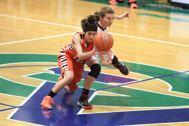 Chaparral guard Abigail Delgado and Dimond of Anchorage, Alaska guard Nikki Forrey chase a loose ball during their game at the Gator Winter Classic tournament Wednesday, Dec. 31, 2014 at Green Val ...